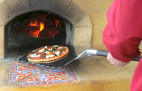 wood fired oven pizza shovel tool also known as a pizza l