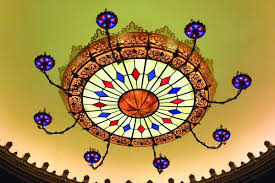 custom crafted of steel blown glass and acrylic the stanley chandelier is 35 feet in diameter 17 feet tall and weighs 7 000 pounds