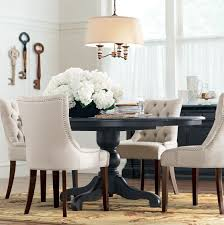 black round table. A Round Dining Table Makes For More Intimate Gatherings. Black O