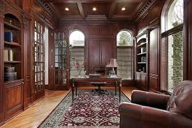 luxurious home office. Luxurious Home Office With Extensive Wood Paneling, Ceiling, Floor, Rich Rug, Small Desk And Over-sized Leather Armchair O