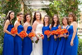 ... color of flowers, or you can incorporate a bit of blue and white to  match your gown. The groomsmen can wear tuxedos with orange ties and a royal  blue ...