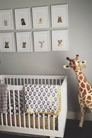 adorable gender neutral nursery with gray walls adorned with sharon montrose the animal print art