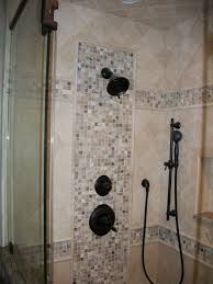 onyx mosaic pattern on valve wall with double mosaic band travertine tile shower