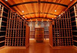 barrel ceiling with racking peninsulas bellevue custom wine cellar