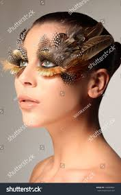 decorative feather make up like the wing of a bird enhancing and surrounding the green