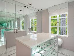 gleaming large glass walk in closet with crystal chandelier and vibrant lighting best glass walk in closet designs ideas decorations