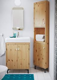 brown bathroom furniture. a small bathroom with washbasin cabinet and corner in light brown furniture v
