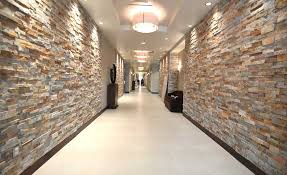 gold stacked stacked stone walls in hallway of hotel dimensional interior stone veneer radius wall