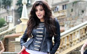 a dream girl photo of kajal agarwal in black leather jacket white t shirt open hair
