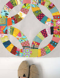 Curved Piecing Tutorial: A Guide to Sewing Curves & Quilt Created with Curved Piecing, Hanging on Wall Adamdwight.com