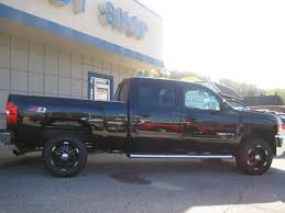 Raised Chevy 2500 HD with Rims - 1 | MadWhips