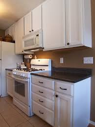 painting oak cabinets white how to repaint kitchen cabinets white paint my kitchen cabinets