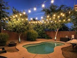 outdoor string lights over pool in the backyard will help with night time ambiance i would