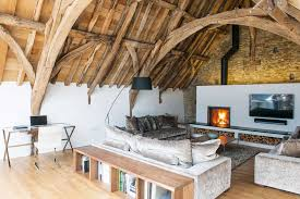 A cosy living area in the corner of a barn conversion design with open plan  space