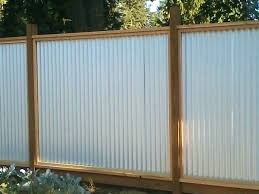 corrugated metal fence wood