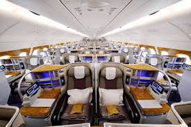 First class consists of 2 rows of closed as the tray tables are in the armrests the width of the seats 46ab and 46jk is reduced a little. Emirates Business Class Reviews Comparing A380 And 777