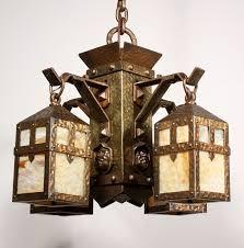 unusual antique arts crafts figural chandelier with monks heads c 1900 preservation station nashville tn