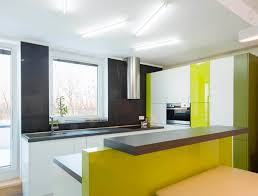 generally splashbacks are glued directly to the wall but can be fixed using bolts with dome nuts if you want the option of removing the splashback at a