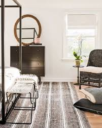 modern bedroom with black and white striped area rug