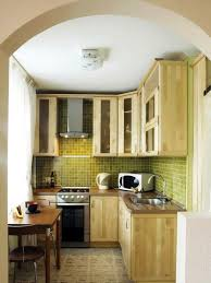 mini kitchen units large refrigerator hanging light metal cabinet oven mahogany bar stool brick stone wall