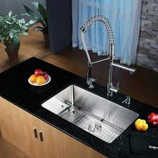 32 x 19 undermount kitchen sink with faucet and soap dispenser