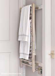 gray bathroom with wall mount towel warmer