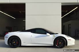 white vinyl wrapped ferrari 458 spider vith black roof