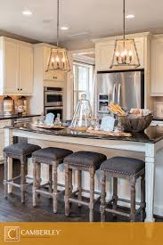 Rustic chandeliers, perfectly hung above the Landon's kitchen island,  illuminate delectable dishes at dinner