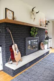 black painted fireplace painted brick fireplace painted fireplace how to paint a brick
