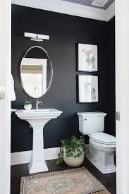 black and white powder room with blush pink vintage rug