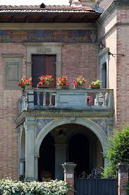 File:A balcony with red flowers, Siena - 1340.jpg