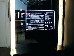 mirror tv cover behind mirror smart mirror in television showroom mirror cover diy mirror mirror tv cover