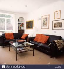 Living Room Black Leather Sofa Orange Cushions On Black Leather Sofas In Living Room With Beige
