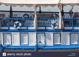 Cabin Windows detail of a blue and white painted dahabiya showing deck cabin 1052 by uwakikaiketsu.us