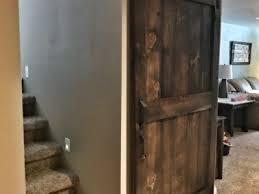 custom j track bat closet and stair sliding barn door solution dark walnut finish