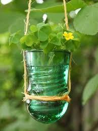 21 use a glass insulator as a flower pot