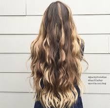 to create a bohemian hairstyle curl your hair with a curling wand to add texture