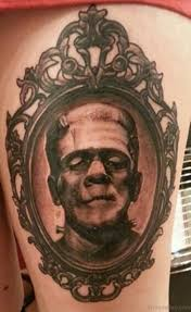 frame tattoo designs. Grey Ink Portrait Tattoo On Thigh Frame Designs O