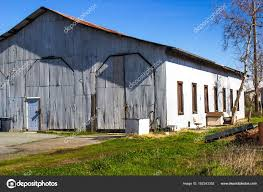 old corrugated tin building and warehouse abandoned stock photo