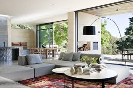 tropical living rooms: exterior tropical living room design idea with grey accents sleeper sofa plus catchy round tier