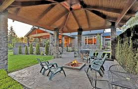 a patio outdoor fire pit inside of a pavilion under the roof
