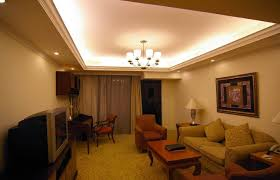 living room lighting ideas low ceiling white fabric tall window curtain white fabric cushion gold metal