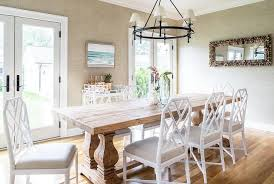 wood trestle dining table with white bamboo chairs