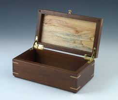 this small keepsake box is made of peruvian walnut with a spalted maple lid i inlaid a piece of dyed veneer for the sun the hinges are brass quadrants