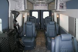 this sprinter features a unique steel blue interior most noticeable on the plush leather captain s chairs cmi added 7 of these seats including the driver