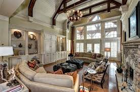 ecru crown molding and vaulted white ceiling with full length palladian windows with columns and