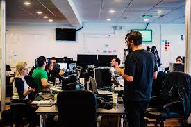 developer office. East Side Games Mobile Game Developer Office Desk Chat