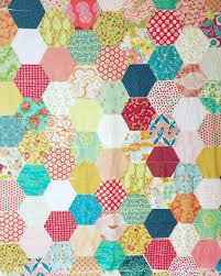 How to make a hexagon quilt with half hexies – free quilt pattern ... & With all your hexies laid out correctly, once again think of them as half  hexies. You will piece them by rows just as you piece a regular patchwork  quilt. Adamdwight.com