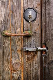 lock key handle and latch on the old wooden door stock photo colourbox