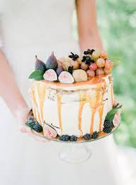 Single Tier Wedding Cake Topped With Fruit Brides